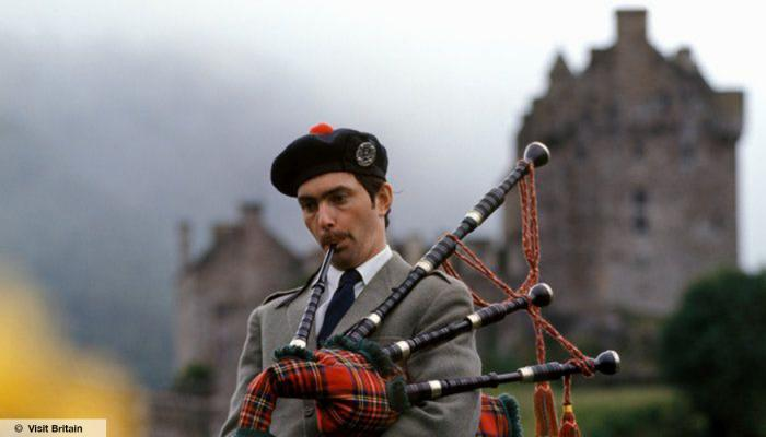 Man with bagpipes, Eilean Donan Castle, Highlands,© Visit Britain